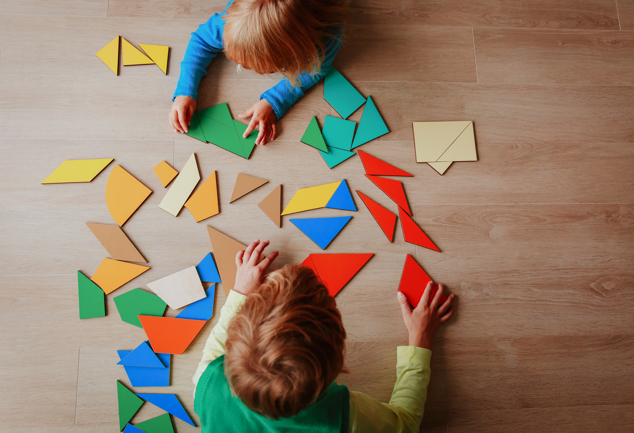Kids Playing With Puzzle Education Concept